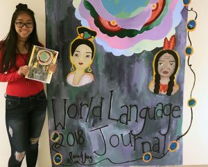 TZHS mural winner with mural and World Language Journal cover
