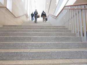 students walk upstairs in campus center