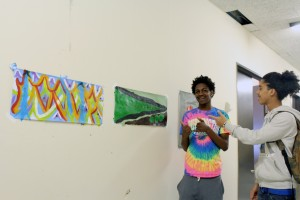 Jailson and Francisco show their painting