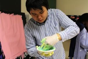 Phillip mixes paint