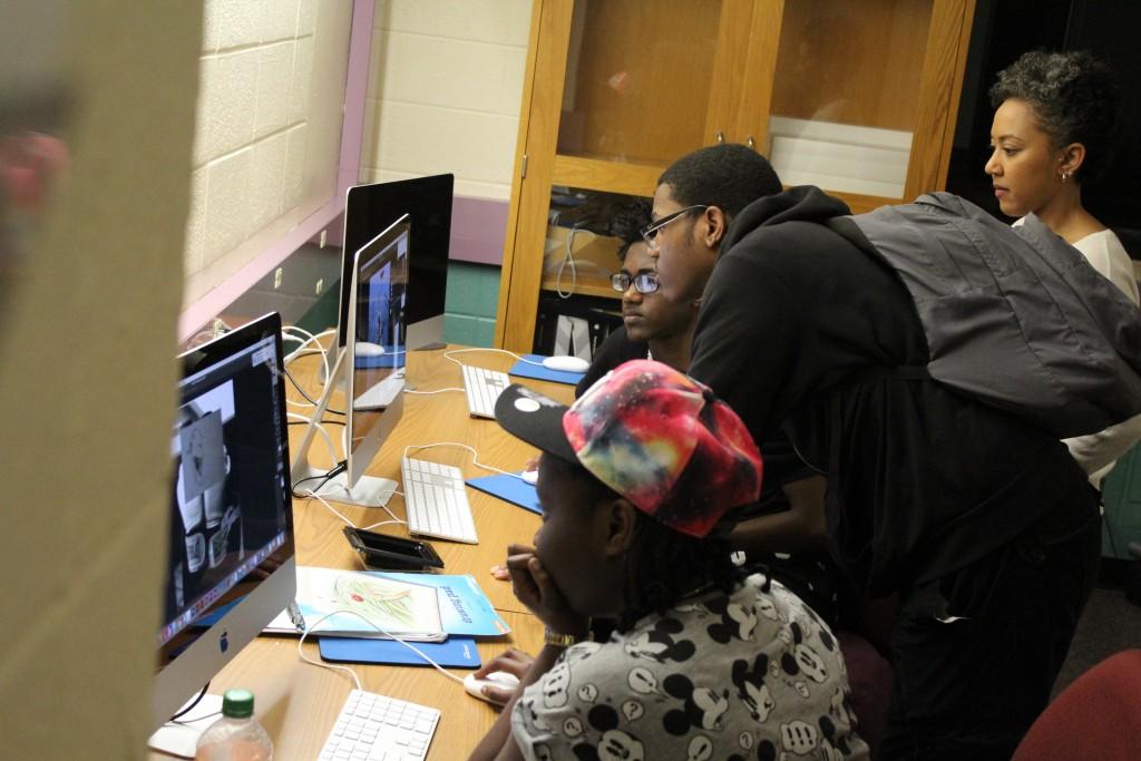 4 students working at Mac computers