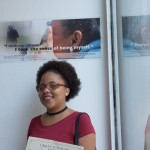 Adilse in front of her poster.