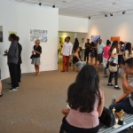 Visitors view In Transit: Voices & Vision prints, Photo by Colleen Locke
