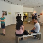 Visitors view posters in the Harbor Gallery. Photo by Colleen Locke.