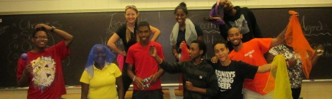 Students and Teacher posing together in their improv class.