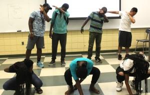 Green team, practcing dance.