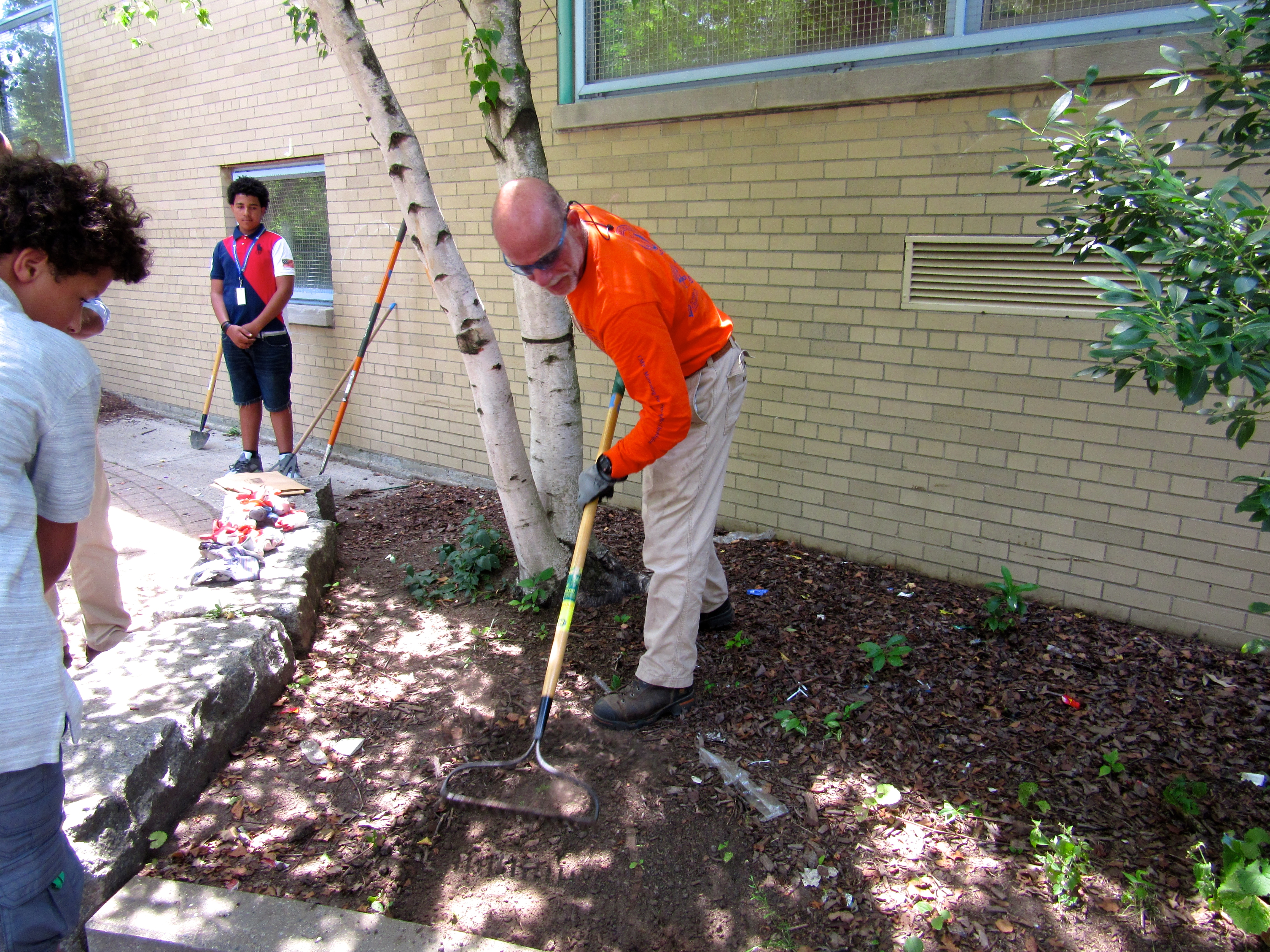 The coordinator demonstrated the Project Reach scholars how to use the rake tool.