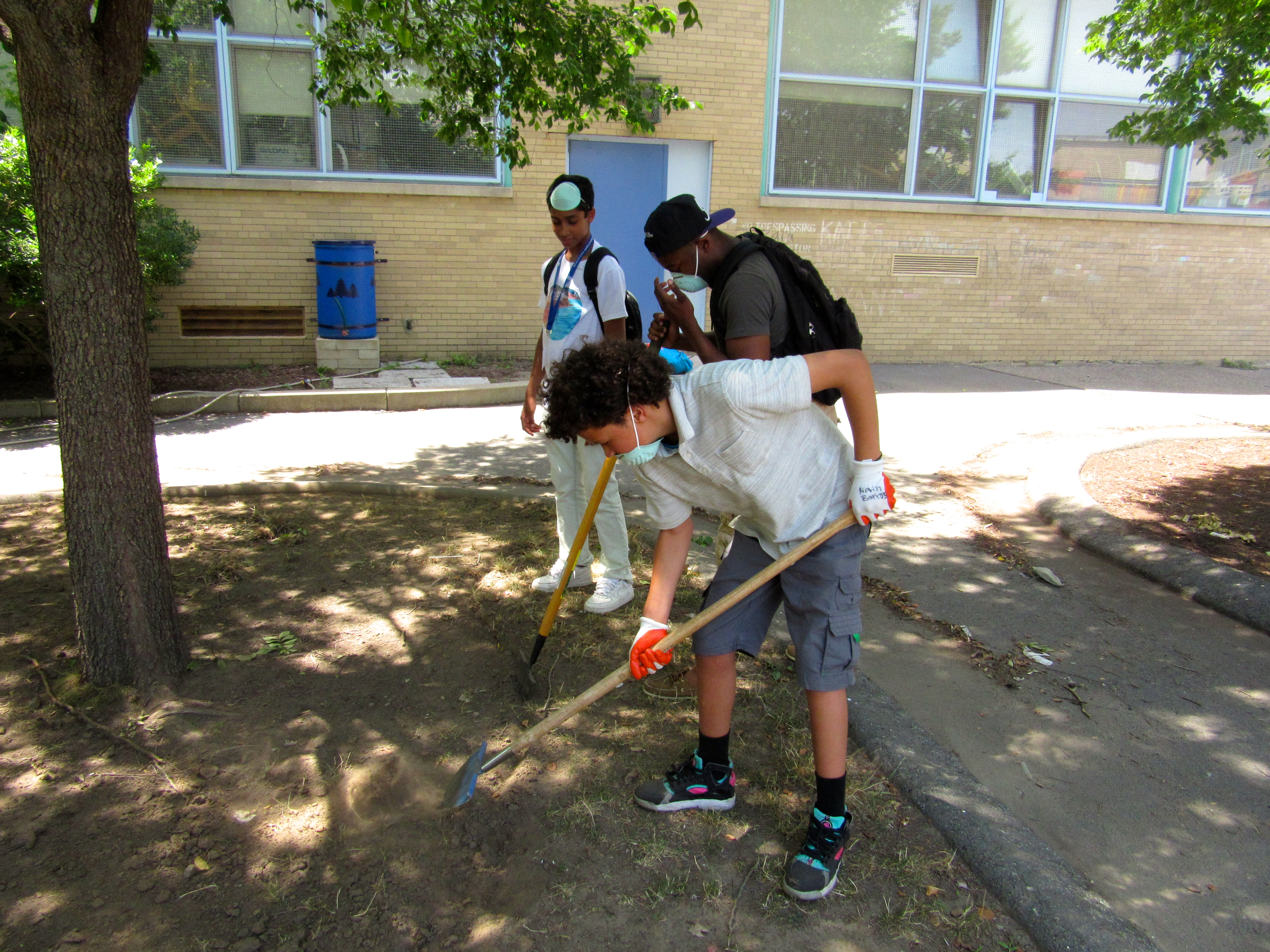 Students helped out digging dirt.