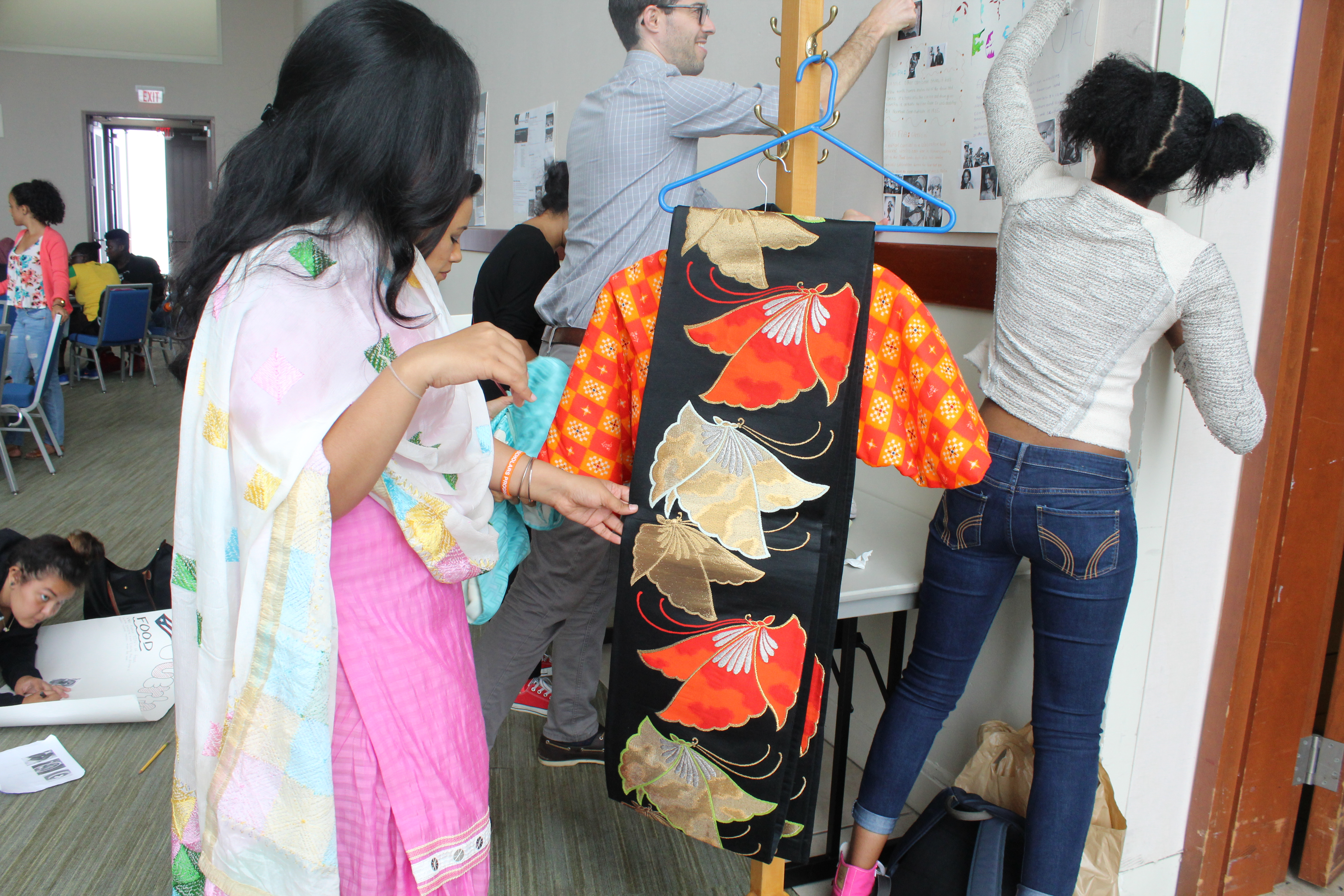 One of the staffs member looked at one of the clothes displayed of their tradition!