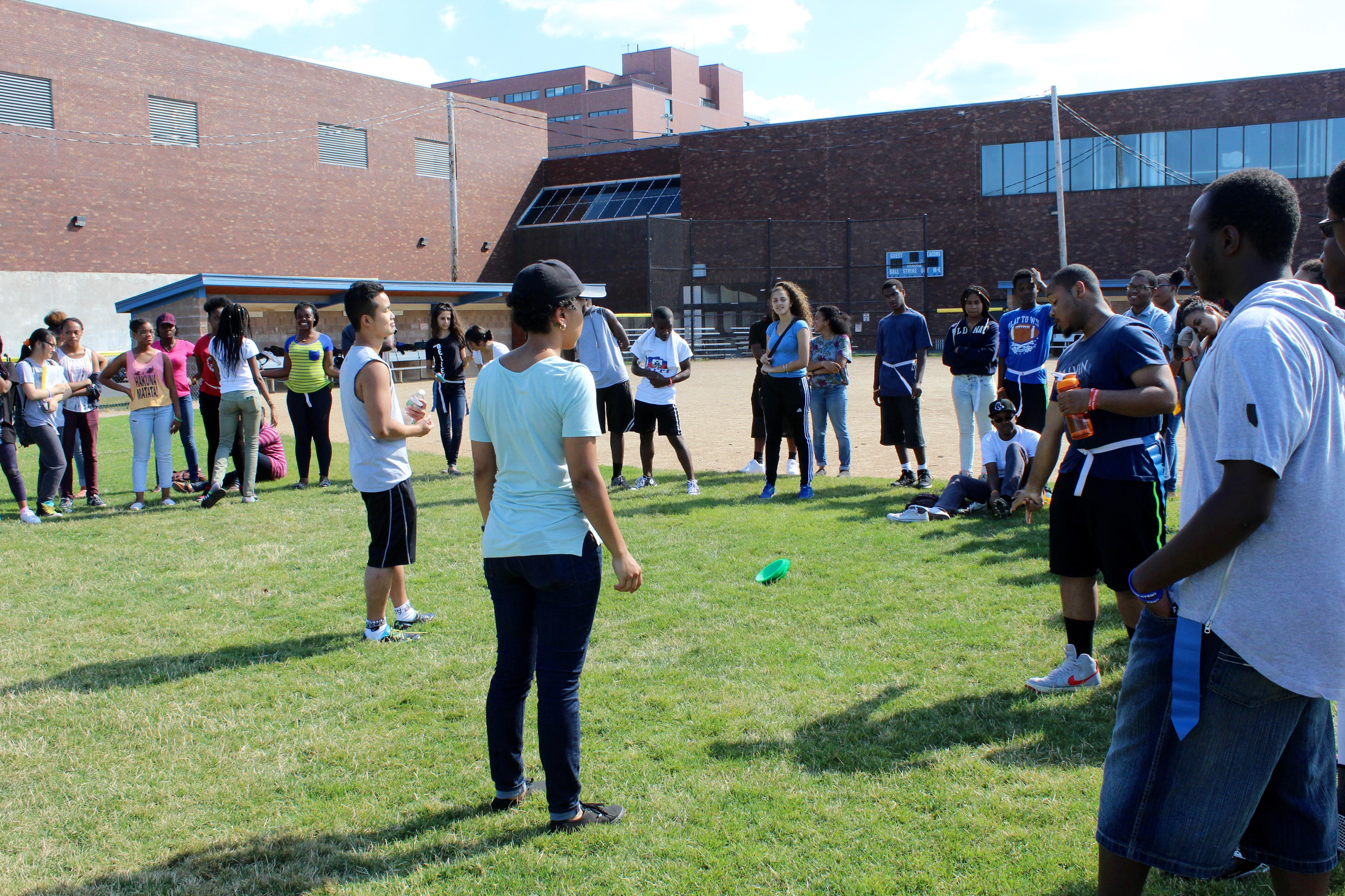 Suamy explained the game rules to students that had never played flag football.