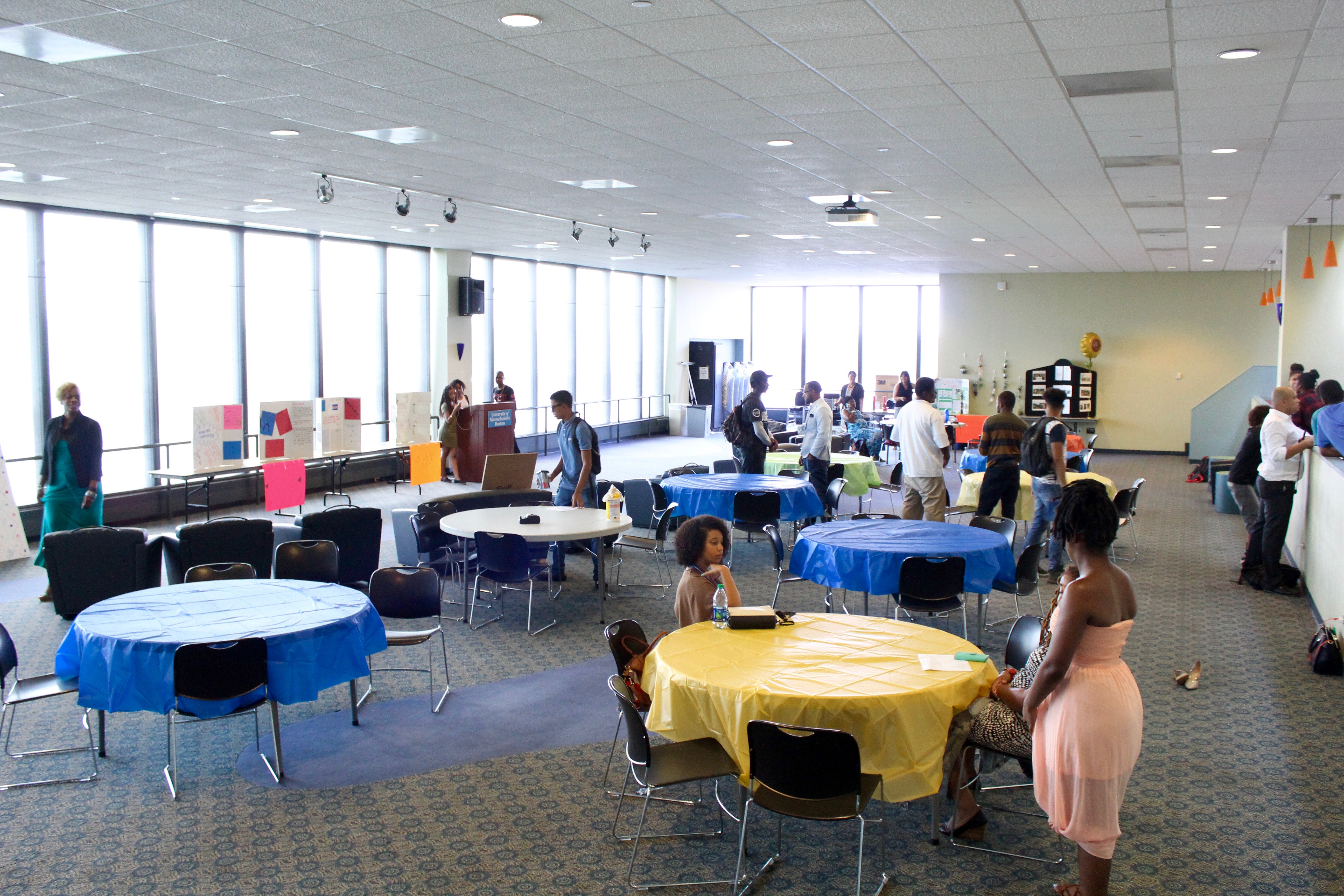 In the evening, the Project REACH setting up tables and their projects at the Ryan Lounge.