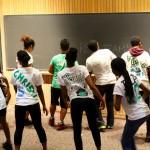Green Team make sure their dance flash their individual art design on the back of their shirt!