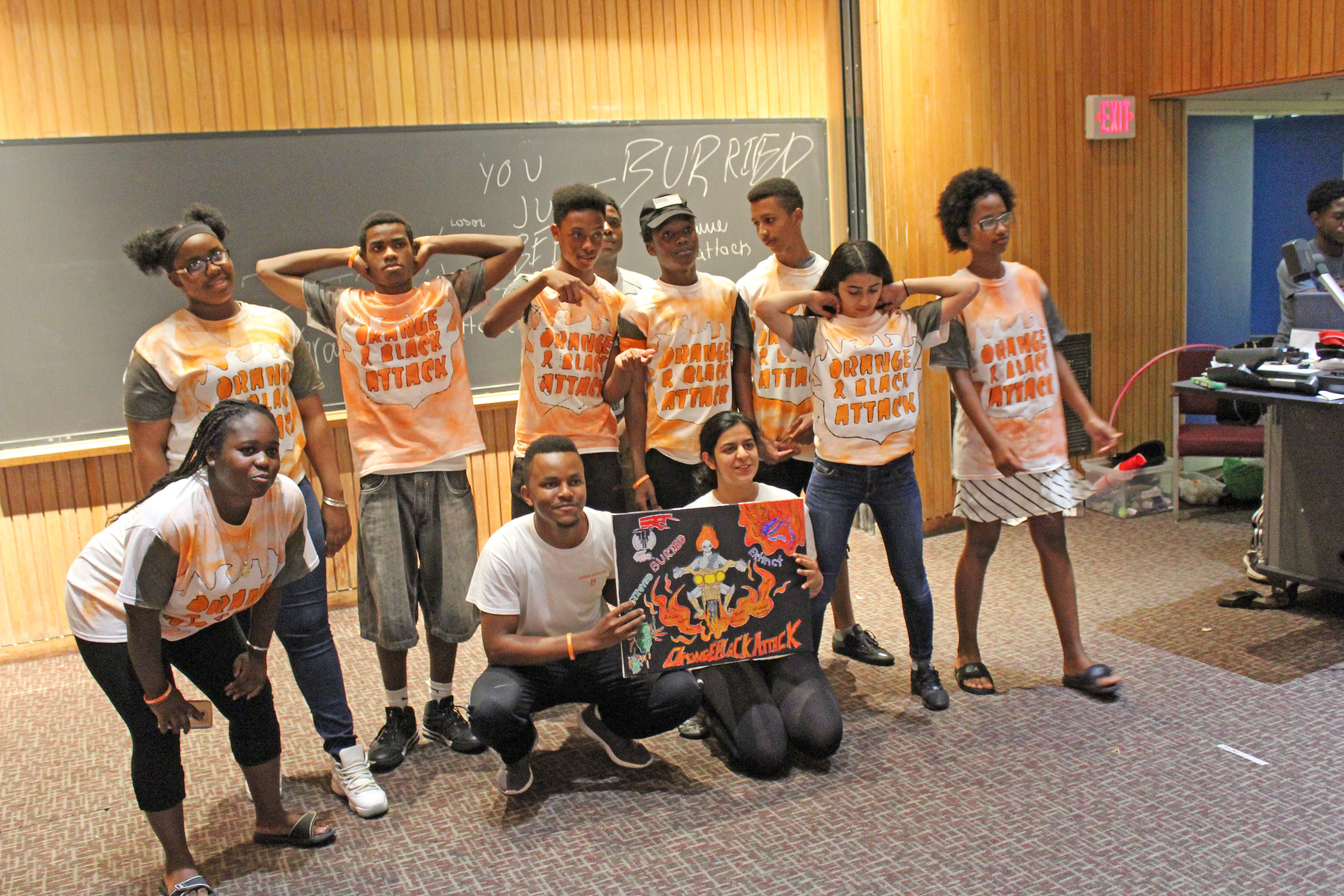 Orange Team posed with their banner.