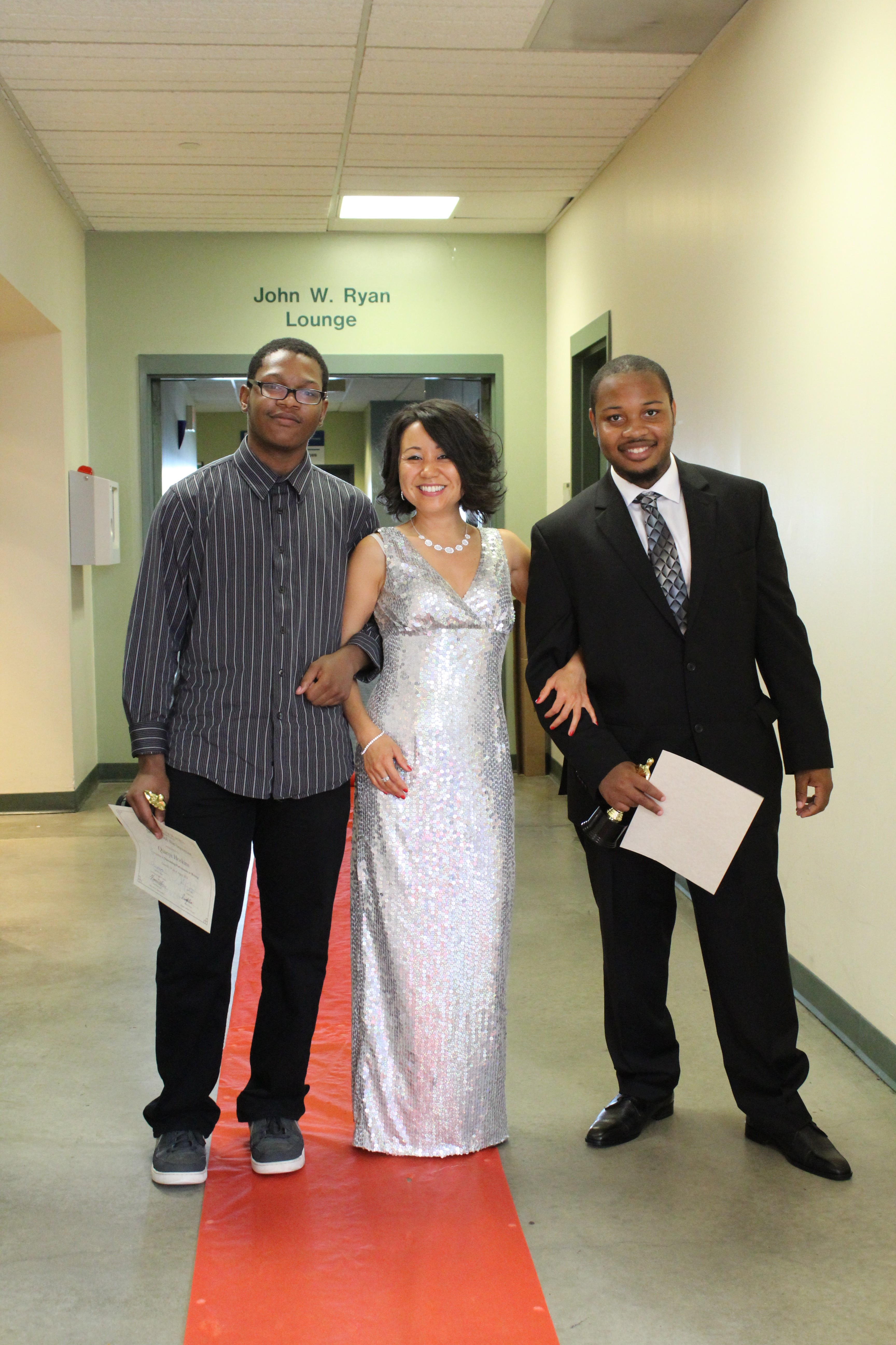 Merissa made a surprise entrance with her sparkling silver dress! She posed with her Urban Scholars students.