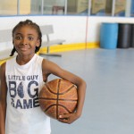 One of the campers poses for a picture! He look like a professional basketball player already!