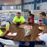 You can see their face, staff and students were playing an intense game of uno together.