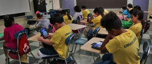 Left side of the classroom captures back of students while they are facing front of the classroom using iPad.