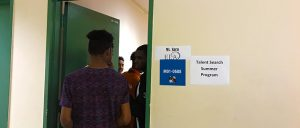 Back of students entering a classroom.