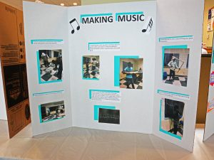 """Photos of students creating and playing drums on poster board poster that says """"Making Music"""""""