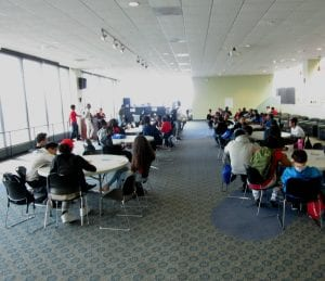 A room full of scholars getting ready for the team competition.