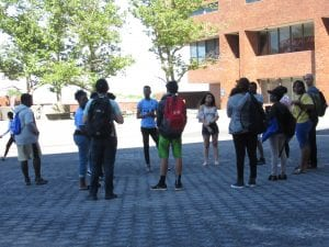 students standing outside in a circle.