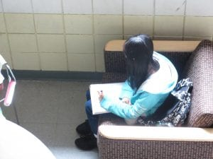 A girl doing her work.