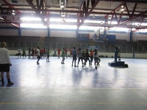 A group of student playing baskball