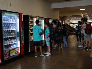 students buying snacks from the vending machine