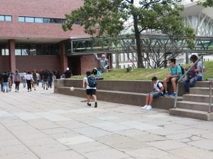 A student running to get the soccer ball.