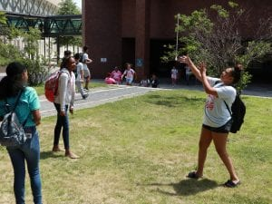 A students playing with a stick.