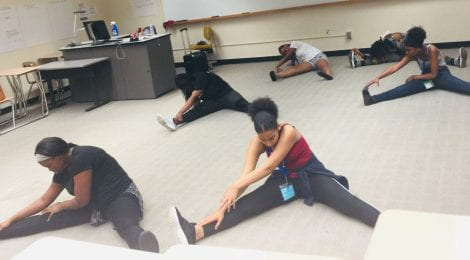 students are stretching pre-dance class