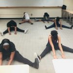 students are stretching before dance class