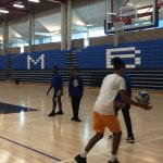 students play basketball in UMass gym