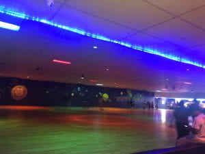 Image of the roller rink with neon lights.