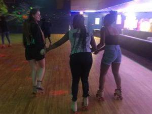 Students helping TA skate.