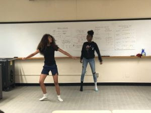 Two students dancing