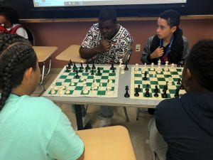 Students playing chess.