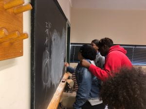 Group of students playing tic tac toe.
