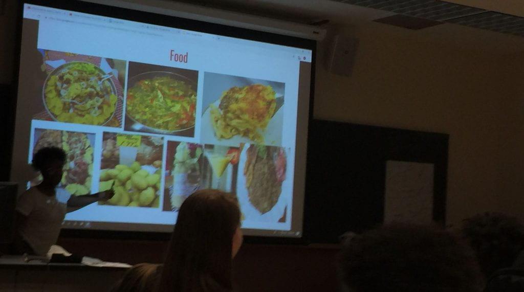 presentation of haitian food by staff