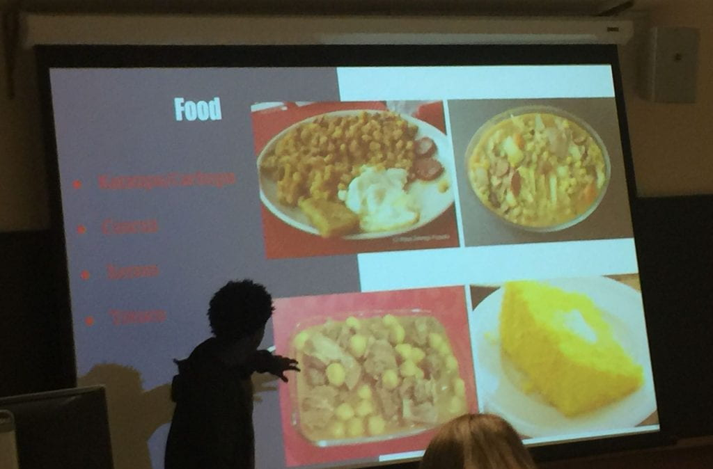 presentation of cape verdean food by staff