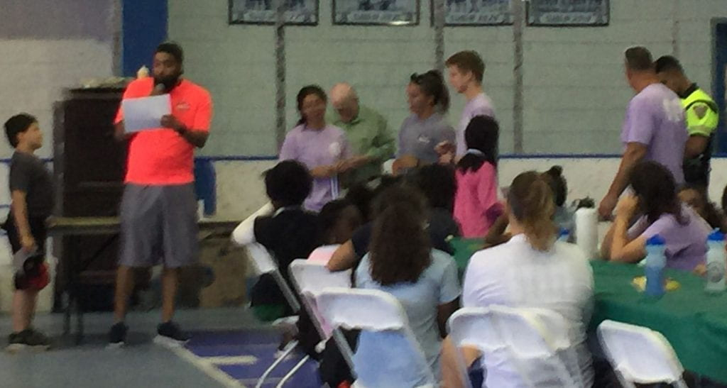kids come up to receive their award