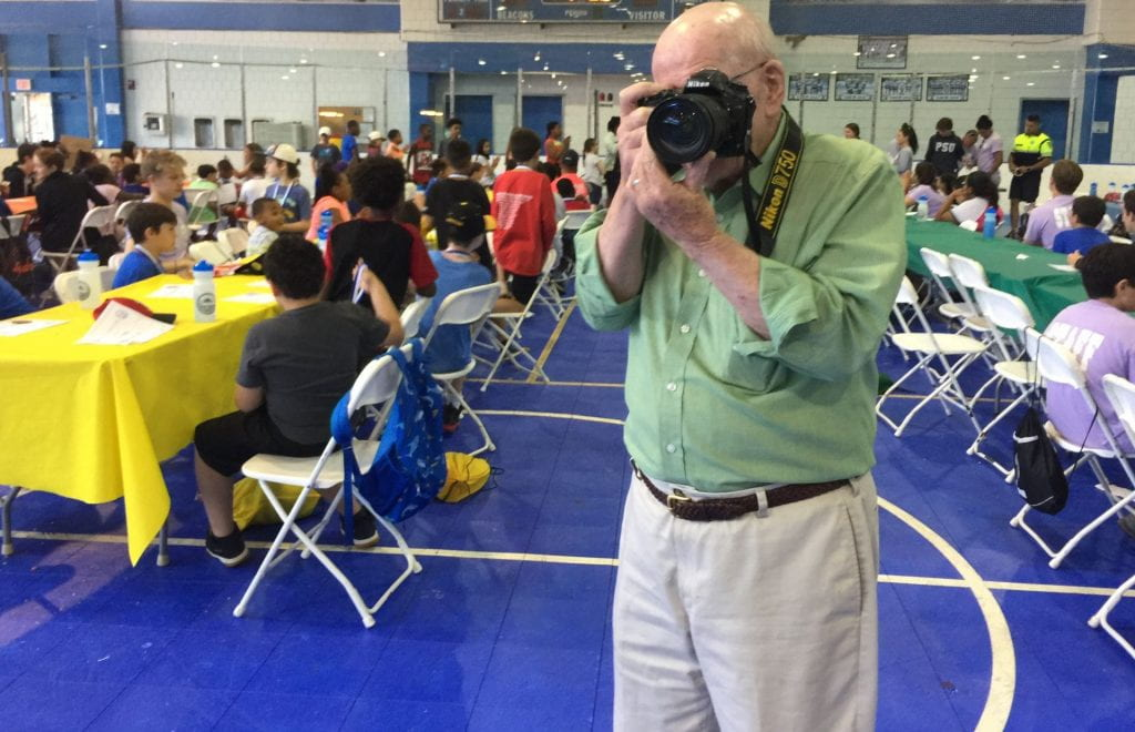 UMB photographer photographing the kids