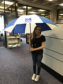 Student Rachel Hoffman with umbrella
