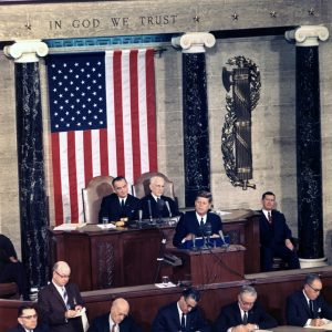 President Kennedy delivers the 1963 State of the Union Address alongside Vice President Lyndon Johnson and Speaker of the House John W. McCormack. (Source: https://commons.wikimedia.org/w/index.php?curid=1395746)