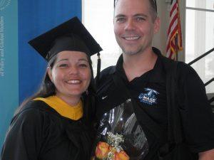Georgianna Melendez poses at graduation with her husband