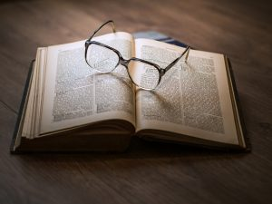 open book and eye glasses