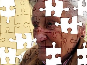 puzzle pieces depicting woman with dementia