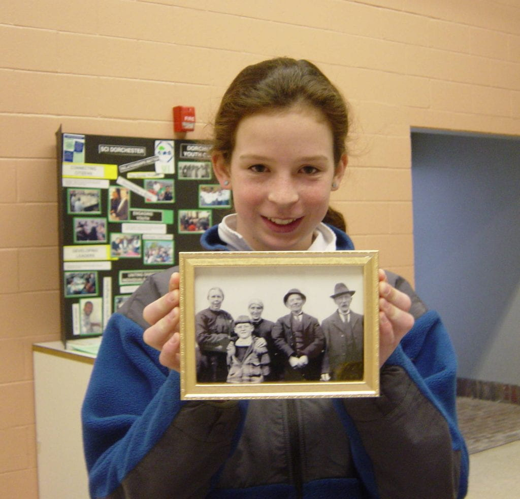Kris Boelitz holding a photograph of her family members.