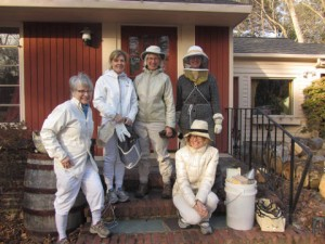 'A group of BEElieve beekeepers poses for a picture at [my] house after the group's first hive opening in Spring of 2012. Hive openings at backyard beekeepers' homes are a large part of educating the public about the hardworking and friendly bees. Many who have hesitated about beekeeping for years need to witness only one hive opening to make up their minds and get started. Pictured, from left to right: Janet Hading Pian, Anne Harris, unidentified, Kaat Vander Straeten, and Janot Mendler de Suarez.' Contributor: Kaat Vander Straeten.