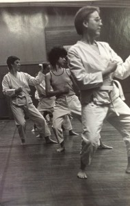McEldowney (center, in tank top) in a martial arts or self-defense class.